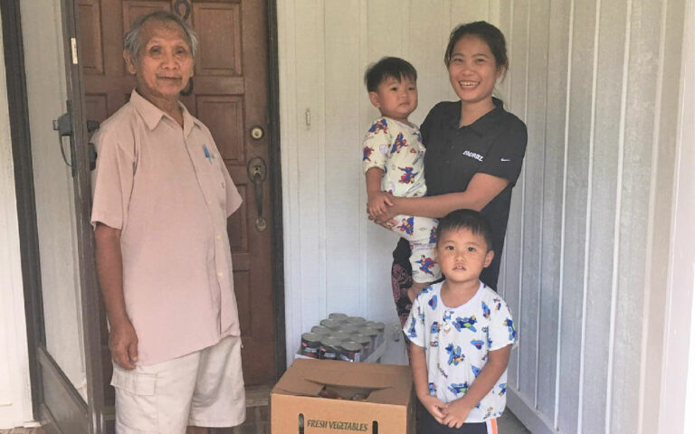 Family Receiving Food Delivery